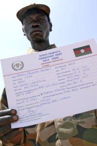 SPLA Soldier Displays Discharge Certificate